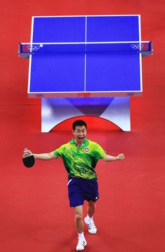 Inspirational Moments: Olympic celebrations - BEIJING - AUGUST 15: Li Ching of Hong Kong China celebrates after defeating Chiang Peng-Lung of Chinese Taipei during a Men's Team Bronze Play-off Round 1 match at the Peking University Gymnasium on Day 7 of the Beijing 2008 Olympic Games on August 15, 2008 in Beijing, China. (Photo by Jamie Squire/Getty Images)