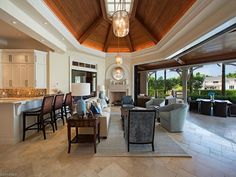3130 Gin Lane, Naples, FL 34102 | Kitchen flows into the family room which opens completely to the outside.  Port Royal