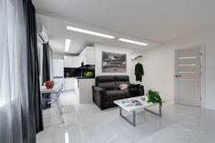 интерьер гостиной-кухни в белых тонах