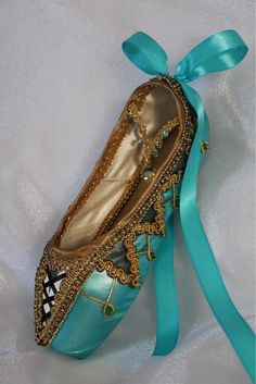 """This intricately decorated ballet shoe makes the perfect gift for that special memory on stage. Made from a NEW pointe shoe that has been carefully embellished, it evokes the spirit of the dance. ☆ It measures approximately 9""""x3. There is a small loop on the back of shoe for hanging."""