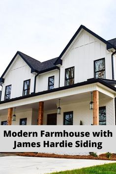 This white farmhouse exterior with black windows is a beautiful high-contrast look. Seen here is HardiePanel vertical siding with HardieTrim batten boards.