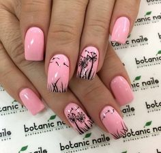 Dandelion inspired pink and black nail art.