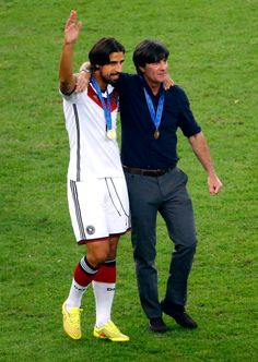 Sami Khedira of Germany celebrates with head coach Joachim Loew after defeating…
