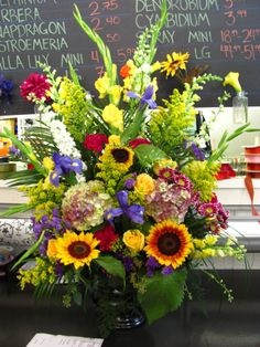 Beautiful local sunflowers make this arrangement. Sunflower Arrangements, Fall Arrangements, Church Flowers, Sunflowers, Hydrangea, Orchids, Floral Wreath, Lily, Wreaths