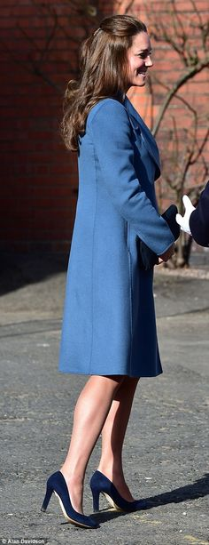 Not long now: The Duchess, who is seven months pregnant with her second child and is due to give birth in April, kept her bump under wraps