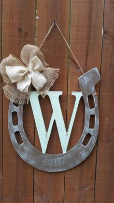 http://scwoodworkart.com/product/horseshoe-w-monogram/ Horseshoe with initial door/wall hanger