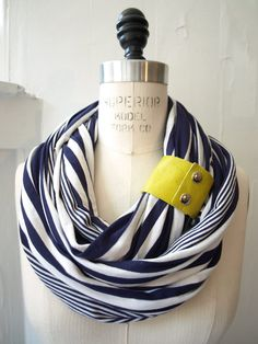Searching for infinity scarfs and came across this chunky stripes with neon leather cuff scarf. Love the concept.