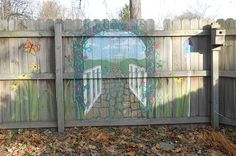 Garden gate mural painted in acrylic on a wooden fence. Located in East Lansing, MI. By Alison Alfredson (Lansing, MI)