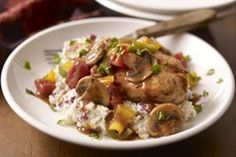 Freshen up your chicken routine with mushrooms, peppers and tomatoes atop creamy mashed potatoes. This easy, flavorful meal is low-fat, too!