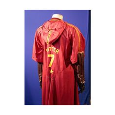 Rear-view of a Gryffindor Quidditch costume - Iconic costumes worn in... ❤ liked on Polyvore featuring harry potter and gryffindor