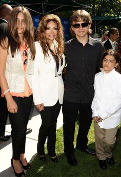 Paris Jackson Can Wear T-Shirts, Couture, and Everything In Between  -  April 3, 2017:     Paris Jackson wore an orange blouse under an ivory vest at the Jackson Family Donation Event for Children on August 8th, 2011.     (L-R) Paris Jackson, La Toya Jackson, Prince Jackson and Blanket Jackson attend the Jackson Family donation event at Children's Hospital Los Angeles on August 8, 2011 in Los Angeles, California.