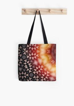 Tote bag with geometric yellow, red, beige and black colored patterns with symmetric angular shapes forming a concentric abstract representation, referring to concepts such as christmas, a warming feeling, or hope / Copyright: Escarpatte #escarpatte #handbag #tote bag #symmetric #pattern #shapes #abstract #concentric #kaleidoscope #geometric #yellow #beige #black