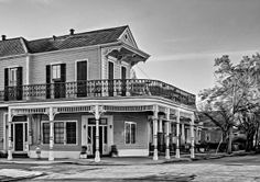 The Charm Of New Orleans Bw.  Every home in New Orleans is different… andeach has a style and color that gives it special charm and character. I would love to sit on this balcony and absorb the evening light. Oil paint filter.