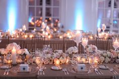 i like the candles and differing candle holders and flower arrangements all around...