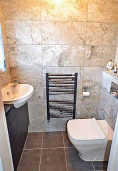 St Annes Drive, Wakefield - Downstairs w.c.  Close couple low flush w.c. with concealed cistern and wash basin on a vanity unit with granite effect work top and chrome mono block mixer tap
