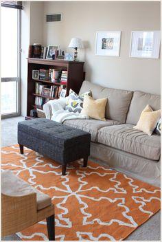 Not sure but I think I like the orange rug