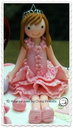 Little girl figurine and cake by ching pranata