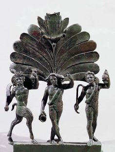 Dionysos, Pan and a satyr; Roman Bronze figurines statue - circa 2nd-3rd AD, from Szomodor in Hungary, metal fitting of a chariot - at the National Museum, Budapest