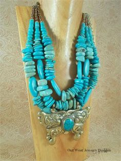 Take a look at this fabulous, triple strand, statement necklace. I put it together using different shades of aqua howlite turquoise nuggets, howlite turquoise ovals and slab beads, rondelles, large heishe beads and gold colored Japanese seed beads. The focal point of this gorgeous piece is the 3-3/4 X 2-3/4 handcrafted brass Repousse pendant of a large butterfly with a bezel set aqua turquoise mosaic cabochon. Repousse is achieved with special tools to create a textured design out o...