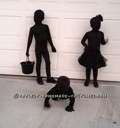 Kids dressed as SHADOWS for Halloween - their mother bought black morph suits for them then layered black clothes over those.
