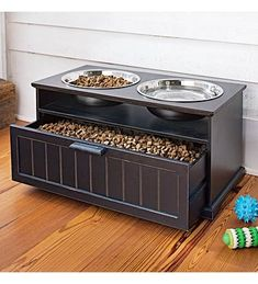 I like the idea of this dog feeder. Not only because of its stylish design and the fact that raised bowls are better for your dogs. I like it that it comes with a drawer underneath that you can store food, treats or your dogs toys. An especially nice feature for dog lovers with limited space.