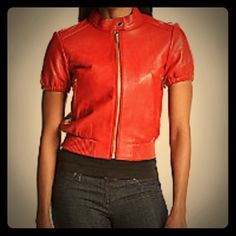10/14/15 HP NWT Michael Kors leather jacket NWT Short leather Michael Kors jacket. Short sleeves, banded waist, zip front closure and gold detail. MICHAEL Michael Kors Jackets & Coats