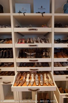 Dressed to the Nines 7 - a custom dressing room: Love the pull-out shoe shelves and the special place for boots (see the lower drawers). #shoecloset #shoeaholic