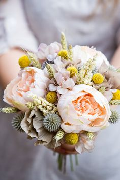 A beautiful bouquet created with 3 fabric peach peony flowers, silk vintage fawn shaded hydrangea heads and rose petals, dried craspedia, dried