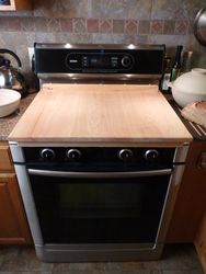 Is your kitchen a little short on counter space? Turn your stove top into a kneading surface or cutting board!