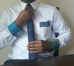 A regular blue shirt will do for the average guy, but for the trendsetter it needs to have beautiful accents. Classy blue shirt with Ankara (African Print) cuffs and accent on the the pocket. *The shi African Inspired Fashion, African Print Fashion, Africa Fashion, Ankara Fashion, African Attire, African Wear, African Women, African Style, African Outfits