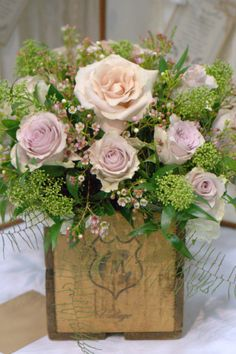 Vintage crate wedding decor vintage wedding flowers soft blush roses and vintage style blooms perfect for nude colour weddings and natural wedding ideas rustic charm wooden crate