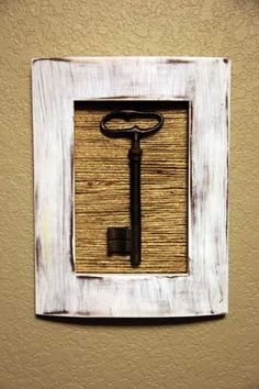 I love how this turned out! an old key from my great-grandmother...painted and sanded a frame and then covered the cardboard with jute twine:) Inspiration from the following blog:     http://addicted2decorating.com/decorate-with-jute-45-ways-to-add-texture-to-diy-projects-accessories-with-jute.html
