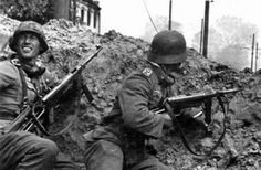 German soldiers, both with MP42 SMG's inside Stalingrad, Russia. 1942.
