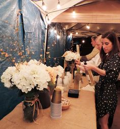 Ashley + Jordan's Wedding Reception | Buying of Supplies, Ordering Custom Napkins + Cups, Table Setting, Flower Arrangements, Hanging of Lights, Tent Setup to Fight the Pouring down Rain | CO