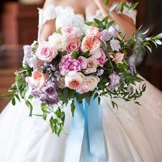 Hello, gorgeous! This dreamy #bouquet designed by @rachelaclingen featured the fluffiest pastel blooms, all tied with an equally soft, powder blue ribbon.