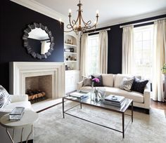 Metallic accents in a navy blue living room