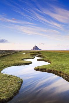 The Mont Saint Michel looks like a magical place, and the path leading to it looks equally magical as well!