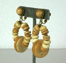 Miriam Haskell Beaded Hoop earrings of tonal wood beads in various shapes and sizes. Large striking scale and not heavy in weight. Clip back adjustable fittings. Diy Earrings, Hoop Earrings, Monet Jewelry, Miriam Haskell, Gold Rhinestone, Vintage Brooches, Custom Jewelry, Brooch Pin, Scale