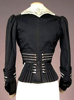 A lady's military-style black and cream wool felt bodice with contrasting embroidery and soutache trim, and silver military-style buttons; image courtesy of Charles A. Whitaker Auction Co.