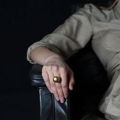 BULB RING by Anna Kiryakova. Porcelain, gold glaze and silver.