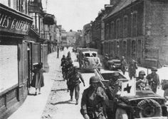Carentan fell on 12 June, when the 2d Battalion, 506th Parachute Infantry, drove into the city from the southwest to join with the 1st Battalion, 401st Glider Infantry, which entered from the northeast.
