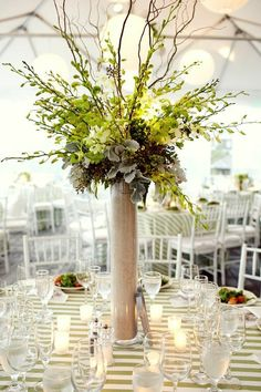 Love this tall centerpiece. by Dianne Marie