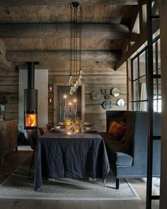 We geet in relaxed mood by looking at the fire. Lovely winter cabin from styled by and published in . Modern Rustic Homes, Winter Cabin, Interior Decorating, Interior Design, Dark Interiors, Home Fashion, Sweet Home, House Design, Decoration