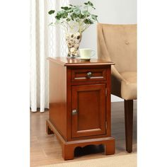 @Overstock - This functional side table has one pull out drawer for storage and one cabinet drawer. This living space accent piece is ideal for use as a table to store your belongings.http://www.overstock.com/Home-Garden/Cherry-Finish-Side-Table/7211009/product.html?CID=214117 $159.99