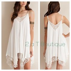 NEW ARRIVAL  Lace slip dress DO NOT buy this listing, comment below to make sure I have your size available and I will make you a personal listing  Solid rayon handkerchief dress featuring lace detailing through out. Adjustable Straps. Fully Lined. Partially-Sheer. Woven. Lightweight.  100%RAYON.      Color: white Will be available in size S(2-4) M(6-8) L(10-12).    TK1525221 2 a T Boutique  Dresses Asymmetrical