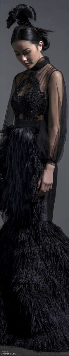 Isabel Sanchis Fall 2016 - makes me think of a girl version of a raven, a very classy version of course