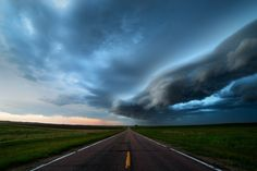 The Crossing - Those days when you try and try and try to see a supercell but nothing goes up near you and so you try to salvage the day by at least getting a nice shelf cloud in western Nebraska. June 2nd, 2015...standing here right next to my buddy Matt Grans and his friend Nancee Rostad...this was a perfect moment with zero traffic on the road and a nice little shelf cloud crossing in front of us. Rare to get a time-lapse of something like this from right in the middle of a road and no…