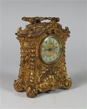 An early 20th century gilt cased mantel clock By the British United Clock Company