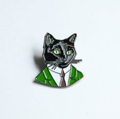 Our enamel pins let you take your favorite Berkley animals on the go! Meet our black cat gentleman from our first collection of animal pins. He is 1 and comes with a straight pin back and metal clasp. All images copyright Ryan Berkley Illustration.