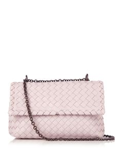 Bottega Veneta's signature Olimpia bag is inspired by the grand design of Italy's Teatro Olimpico. This style is reworked in feminine pale-pink hue for the new season, and woven from leather using the signature intrecciato for a supple yet durable finish. Store your smartphone in the zipped pocket, making use of the accompanying mirror for makeup checks.